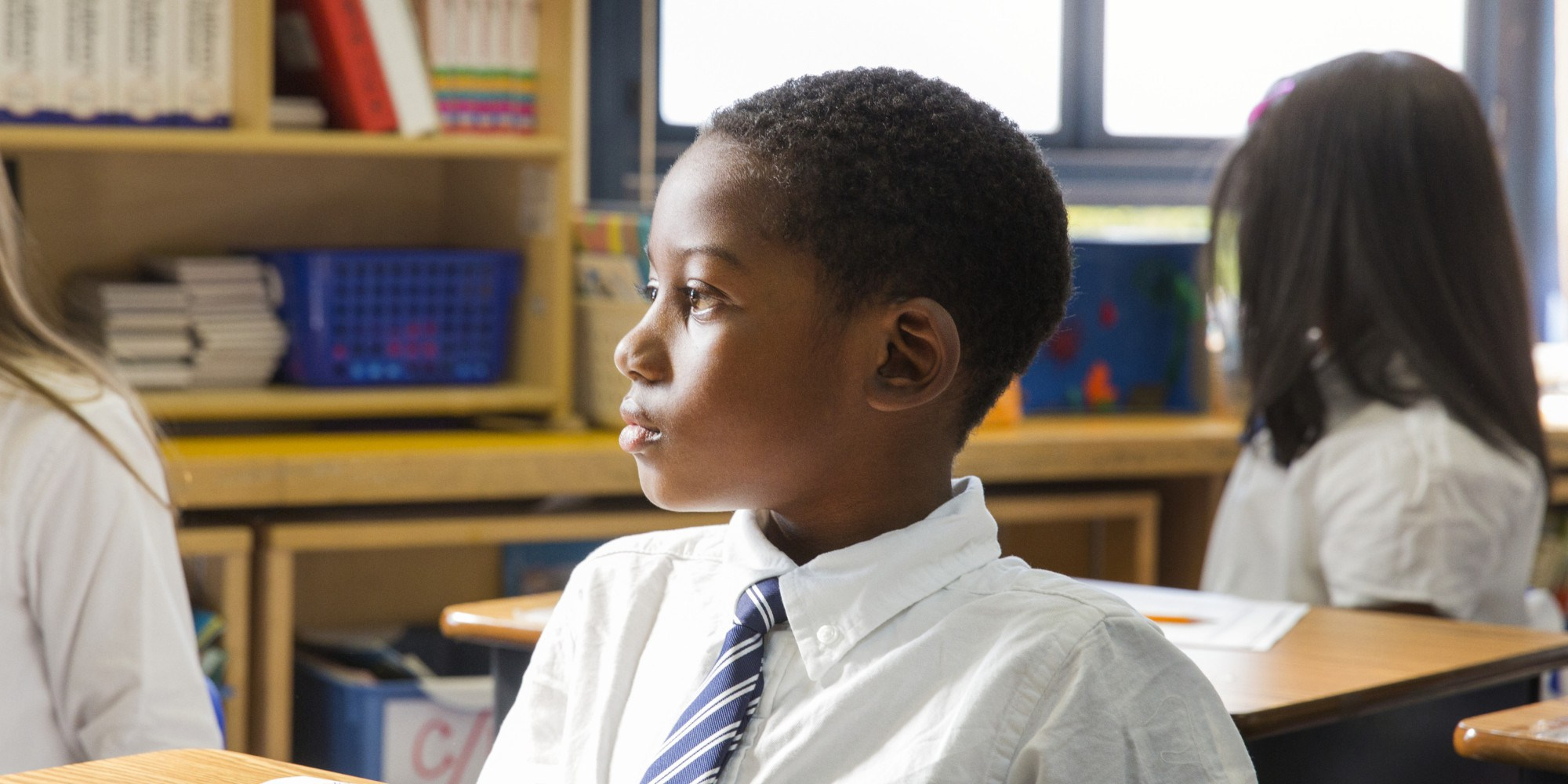 African-American School Boy Sitting at Desk